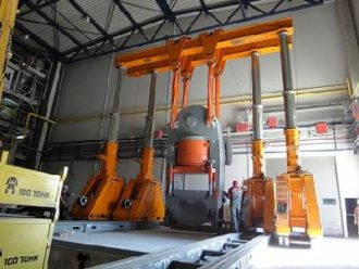 Unloading, turning, handling and placing in the pit of press Sacmi 5000 in Serpukhov