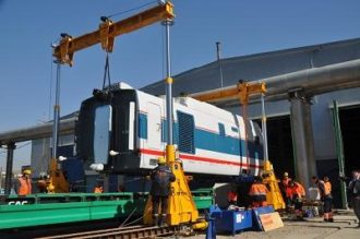 Passenger cars Talgo unloaded from a railway transport in Moscow