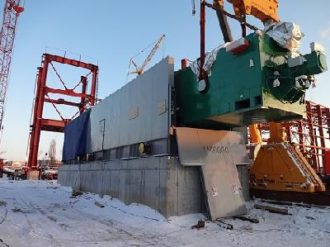 Power equipment loaded, transported, unloaded and set on a foundation in Voronezh
